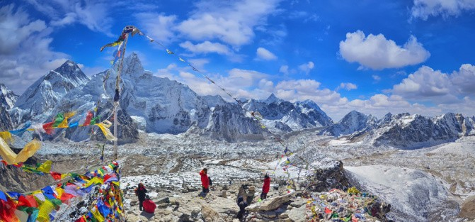 View of Mount Everest and Nuptse with buddhist prayer flags from kala patthar in Sagarmatha National Park in the Nepal Himalaya - Tim Vollmer