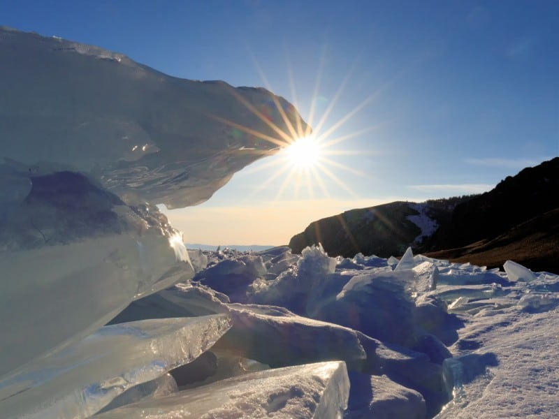 Sunburst behind the a lot of Ice, photography vacations, Tim vollmer Photography